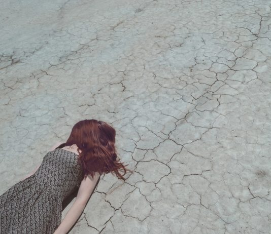 metaphor, falling down, failure, dry, stressed, cracked, panic, anxiety, broken, loss, woman, red hair, dress, laying down, falling, crisis, depression, down, injured, stumbling